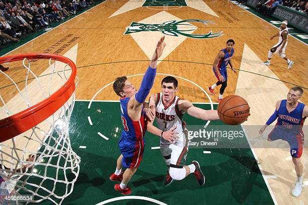 Ersan Ilyasova of the Milwaukee Bucks goes to the basket against the Detroit Pistons on November 25 2014 at the BMO Harris Bradley Center in...