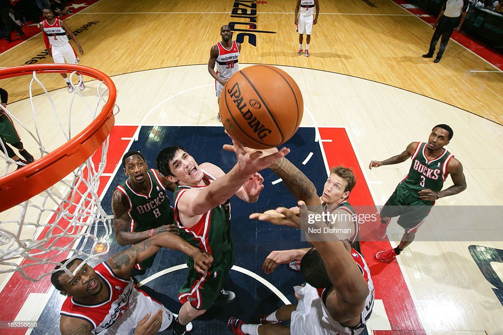 <a gi-track='captionPersonalityLinkClicked' href=/galleries/search?phrase=Ersan+Ilyasova&family=editorial&specificpeople=557070 ng-click='$event.stopPropagation()'>Ersan Ilyasova</a> #7 of the Milwaukee Bucks goes up for a rebound against the Washington Wizards at the Verizon Center on March 13, 2013 in Washington, DC.
