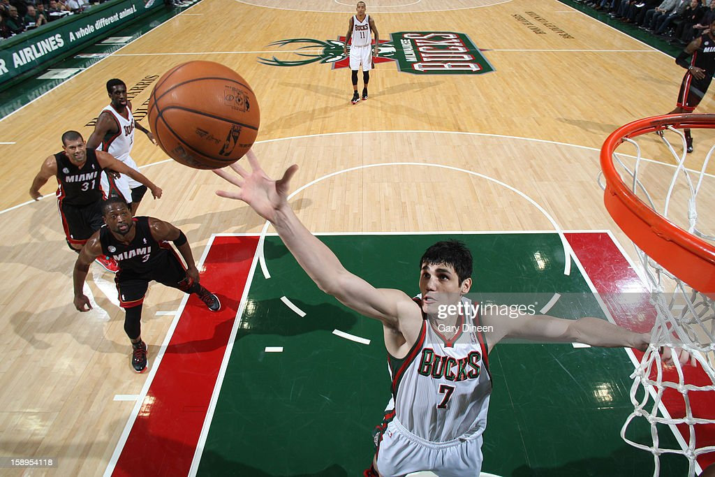 <a gi-track='captionPersonalityLinkClicked' href=/galleries/search?phrase=Ersan+Ilyasova&family=editorial&specificpeople=557070 ng-click='$event.stopPropagation()'>Ersan Ilyasova</a> #7 of the Milwaukee Bucks grabs the rebound against the Miami Heat on December 29, 2012 at the BMO Harris Bradley Center in Milwaukee, Wisconsin.