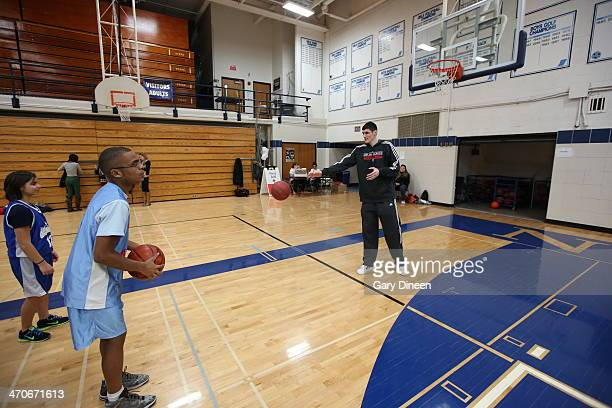 Ersan Ilyasova of the Milwaukee Bucks interacts with participants during a Special Olympics basketball skills clinic on February 11 2014 at Nicolet...
