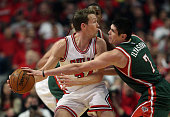 Ersan Ilyasova of the Milwaukee Bucks knocks the ball away from Mike Dunleavy of the Chicago Bulls during the first round of the 2015 NBA Playoffs at...