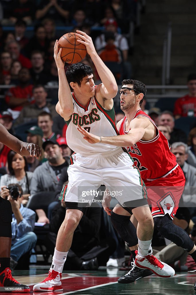 <a gi-track='captionPersonalityLinkClicked' href=/galleries/search?phrase=Ersan+Ilyasova&family=editorial&specificpeople=557070 ng-click='$event.stopPropagation()'>Ersan Ilyasova</a> #7 of the Milwaukee Bucks looks to pass the ball against the Chicago Bulls on January 30, 2013 at the BMO Harris Bradley Center in Milwaukee, Wisconsin.