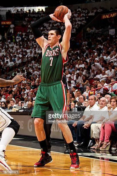 Ersan Ilyasova of the Milwaukee Bucks looks to pass the ball against the Miami Heat in Game One of the Eastern Conference Quarterfinals during the...