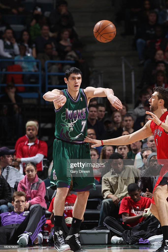 Ersan Ilyasova #7 of the Milwaukee Bucks passes the ball against Andrea Bargnani #7 of the Toronto Raptors on March 2, 2013 at the BMO Harris Bradley Center in Milwaukee, Wisconsin.