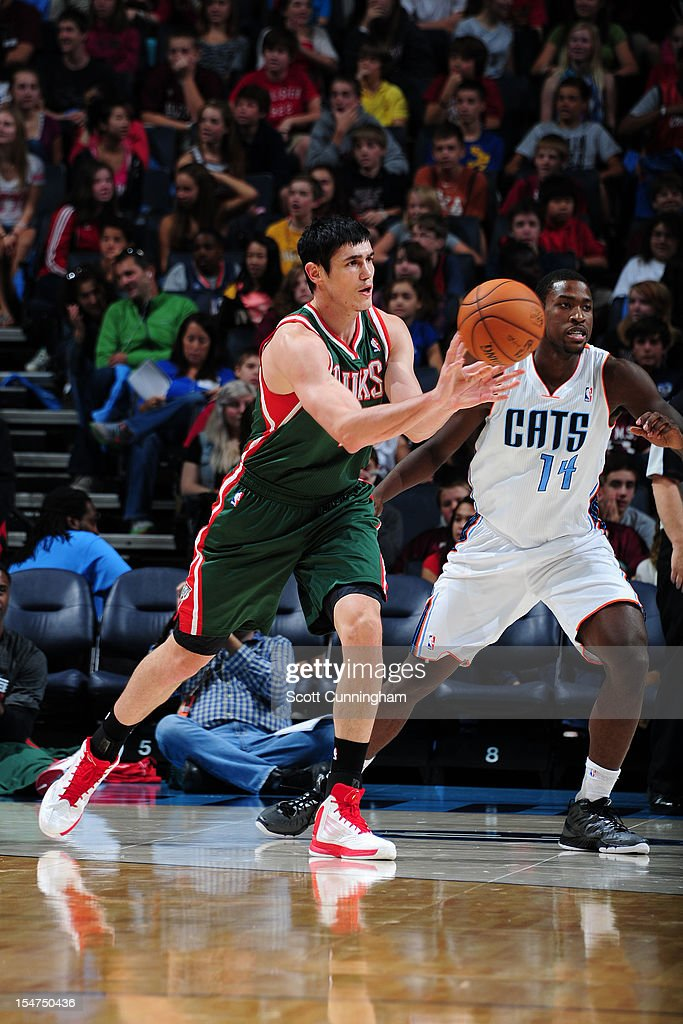 <a gi-track='captionPersonalityLinkClicked' href=/galleries/search?phrase=Ersan+Ilyasova&family=editorial&specificpeople=557070 ng-click='$event.stopPropagation()'>Ersan Ilyasova</a> #7 of the Milwaukee Bucks passes the ball against the Charlotte Bobcats the Time Warner Cable Arena on October 25, 2012 in Charlotte, North Carolina.