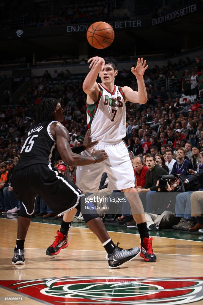 <a gi-track='captionPersonalityLinkClicked' href=/galleries/search?phrase=Ersan+Ilyasova&family=editorial&specificpeople=557070 ng-click='$event.stopPropagation()'>Ersan Ilyasova</a> #7 of the Milwaukee Bucks passes the ball against the Brooklyn Nets on December 26, 2012 at the BMO Harris Bradley Center in Milwaukee, Wisconsin.