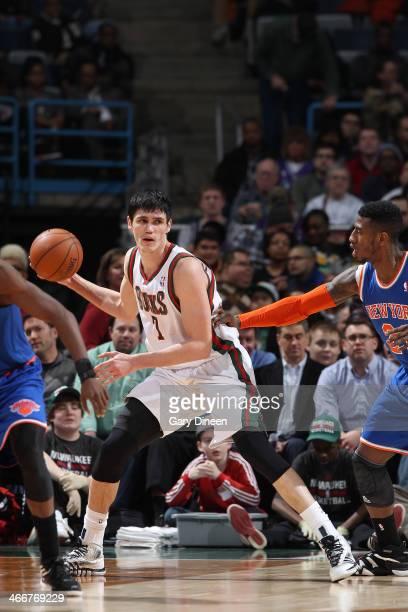 Ersan Ilyasova of the Milwaukee Bucks posts up against Iman Shumpert of the New York Knicks on February 3 2014 at the BMO Harris Bradley Center in...