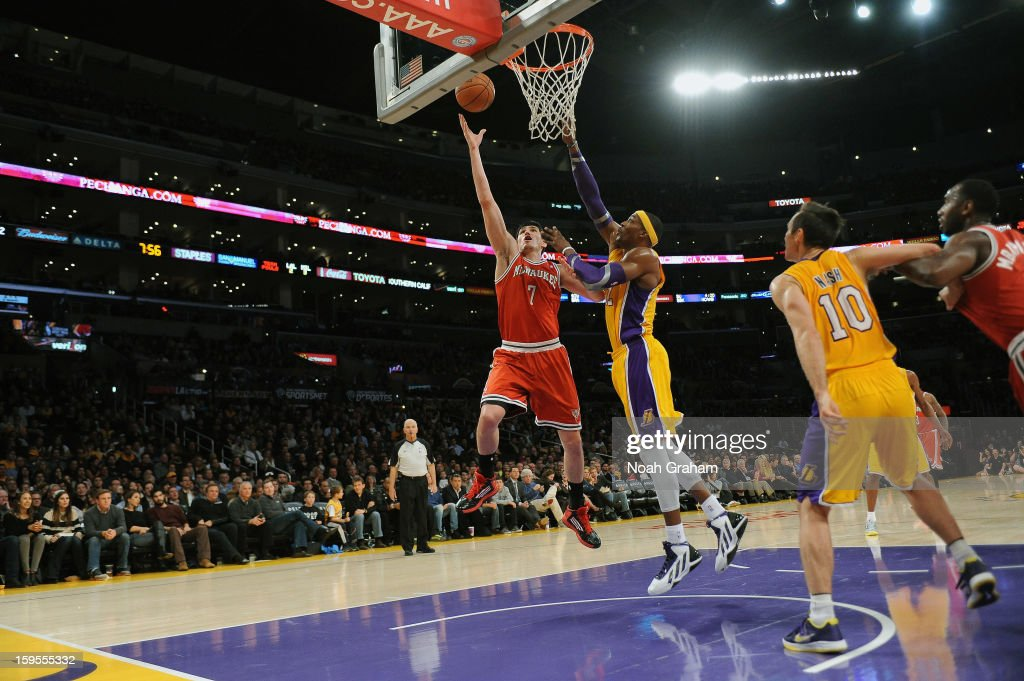 Ersan Ilyasova #7 of the Milwaukee Bucks rises for a shot against Dwight Howard #12 of the Los Angeles Lakers at Staples Center on January 15, 2013 in Los Angeles, California.