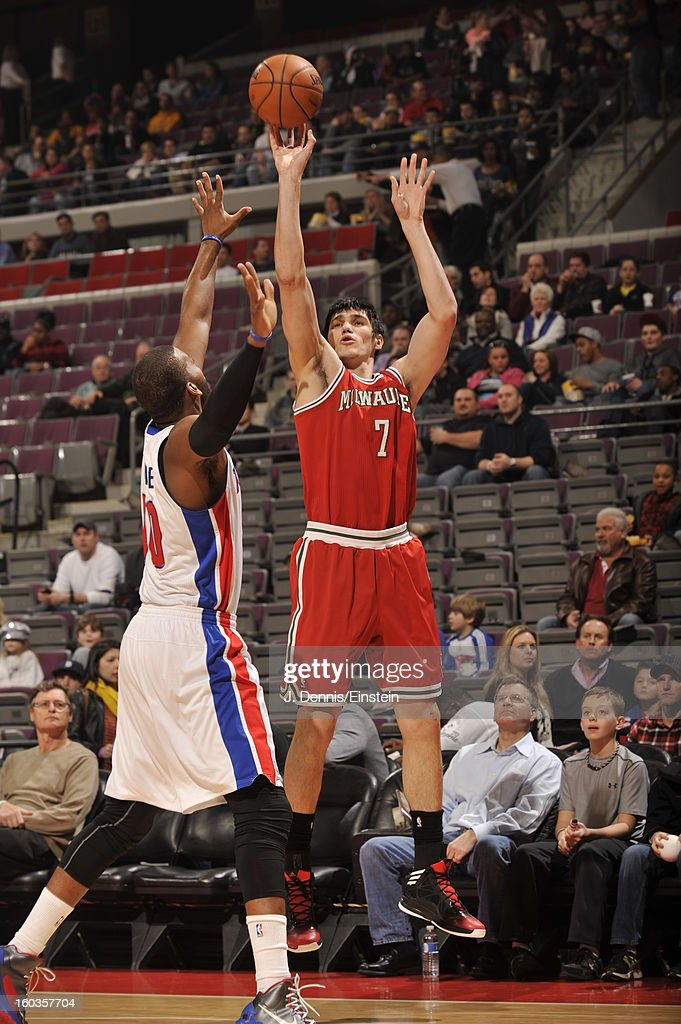 Ersan Ilyasova #7 of the Milwaukee Bucks shoots a deep shot against <a gi-track='captionPersonalityLinkClicked' href=/galleries/search?phrase=Greg+Monroe&family=editorial&specificpeople=5042440 ng-click='$event.stopPropagation()'>Greg Monroe</a> #10 of the Detroit Pistons during the game on January 29, 2013 at The Palace of Auburn Hills in Auburn Hills, Michigan.