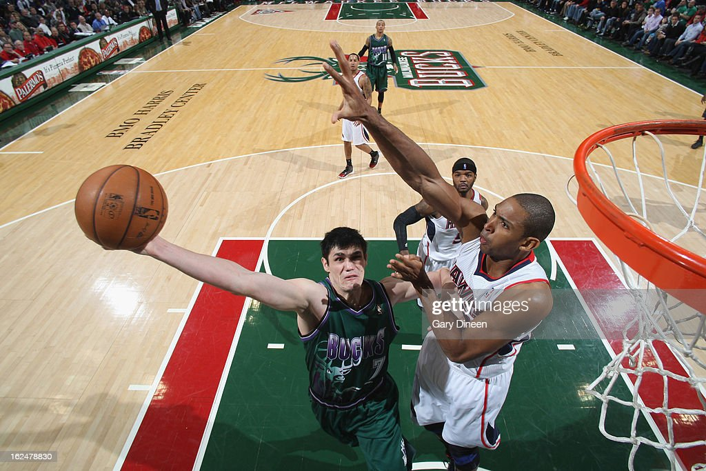 Ersan Ilyasova #7 of the Milwaukee Bucks shoots against Al Horford #15 of the Atlanta Hawks on February 23, 2013 at the BMO Harris Bradley Center in Milwaukee, Wisconsin.