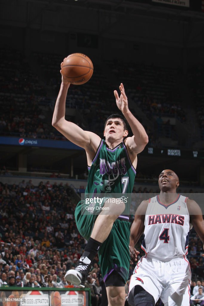 <a gi-track='captionPersonalityLinkClicked' href=/galleries/search?phrase=Ersan+Ilyasova&family=editorial&specificpeople=557070 ng-click='$event.stopPropagation()'>Ersan Ilyasova</a> #7 of the Milwaukee Bucks shoots against <a gi-track='captionPersonalityLinkClicked' href=/galleries/search?phrase=Anthony+Tolliver&family=editorial&specificpeople=4195496 ng-click='$event.stopPropagation()'>Anthony Tolliver</a> #4 of the Atlanta Hawks on February 23, 2013 at the BMO Harris Bradley Center in Milwaukee, Wisconsin.