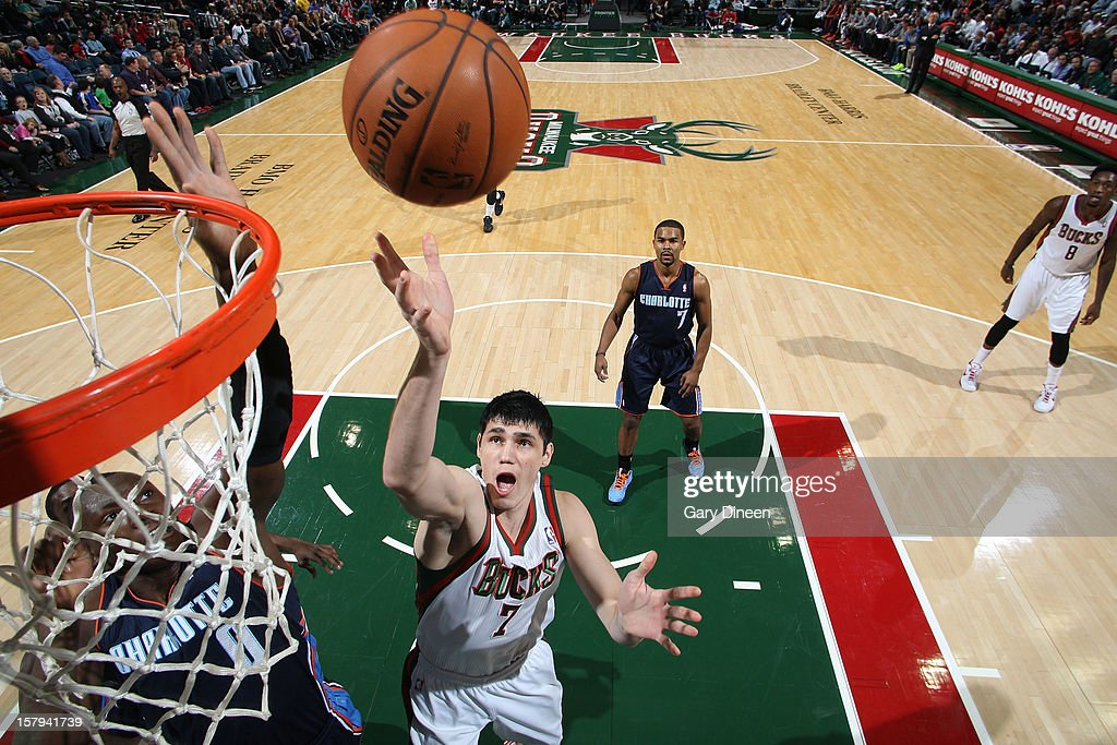 Ersan Ilyasova #7 of the Milwaukee Bucks shoots against Bismack Biyombo #0 of the Charlotte Bobcats during the game on December 7, 2012 at the BMO Harris Bradley Center in Milwaukee, Wisconsin.