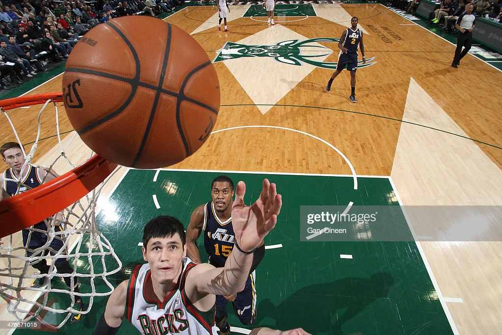 Ersan Ilyasova #7 of the Milwaukee Bucks shoots against Derrick Favors #15 of the Utah Jazz on March 3, 2014 at the BMO Harris Bradley Center in Milwaukee, Wisconsin.