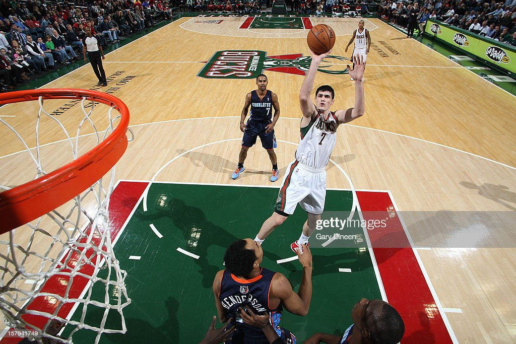 <a gi-track='captionPersonalityLinkClicked' href=/galleries/search?phrase=Ersan+Ilyasova&family=editorial&specificpeople=557070 ng-click='$event.stopPropagation()'>Ersan Ilyasova</a> #7 of the Milwaukee Bucks shoots against Gerald Henderson #9 of the Charlotte Bobcats during the game on December 7, 2012 at the BMO Harris Bradley Center in Milwaukee, Wisconsin.