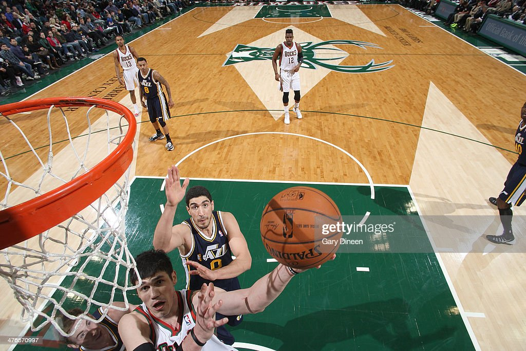 Ersan Ilyasova #7 of the Milwaukee Bucks shoots against (L-R) Gordon Hayward #20 and Enes Kanter #0 of the Utah Jazz on March 3, 2014 at the BMO Harris Bradley Center in Milwaukee, Wisconsin.
