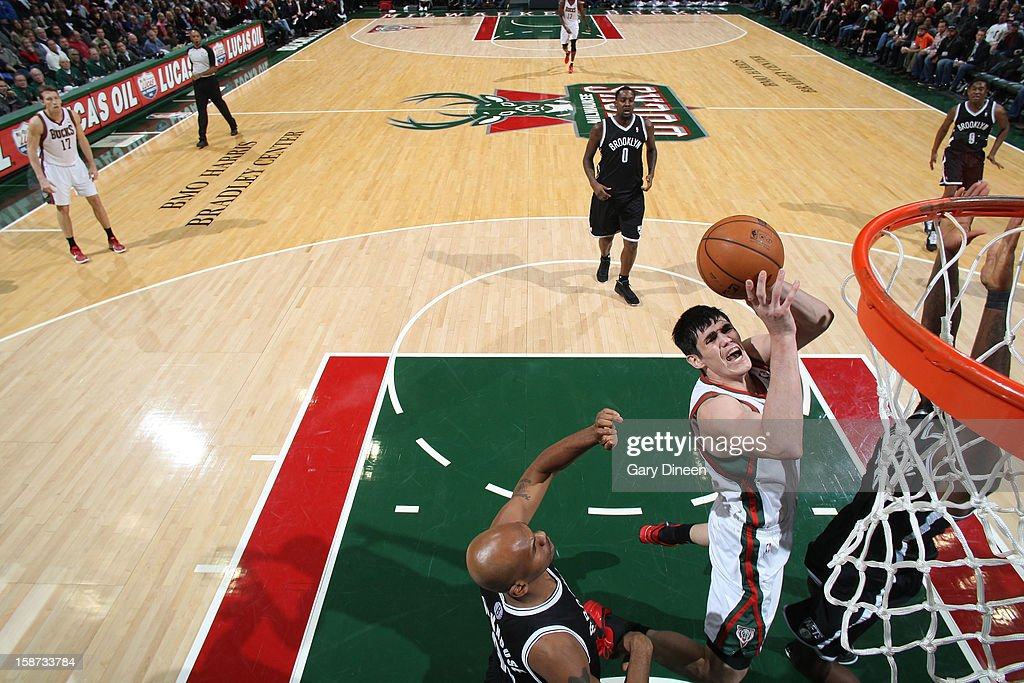 <a gi-track='captionPersonalityLinkClicked' href=/galleries/search?phrase=Ersan+Ilyasova&family=editorial&specificpeople=557070 ng-click='$event.stopPropagation()'>Ersan Ilyasova</a> #7 of the Milwaukee Bucks shoots against <a gi-track='captionPersonalityLinkClicked' href=/galleries/search?phrase=Jerry+Stackhouse&family=editorial&specificpeople=201683 ng-click='$event.stopPropagation()'>Jerry Stackhouse</a> #42 of the Brooklyn Nets during the NBA game on December 26, 2012 at the BMO Harris Bradley Center in Milwaukee, Wisconsin.