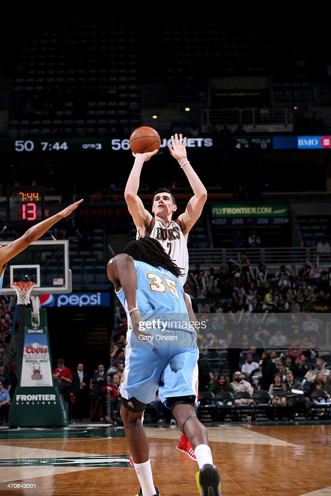 <a gi-track='captionPersonalityLinkClicked' href=/galleries/search?phrase=Ersan+Ilyasova&family=editorial&specificpeople=557070 ng-click='$event.stopPropagation()'>Ersan Ilyasova</a> #7 of the Milwaukee Bucks shoots against <a gi-track='captionPersonalityLinkClicked' href=/galleries/search?phrase=Kenneth+Faried&family=editorial&specificpeople=5765135 ng-click='$event.stopPropagation()'>Kenneth Faried</a> #35 of the Denver Nuggets on February 20, 2014 at the BMO Harris Bradley Center in Milwaukee, Wisconsin.