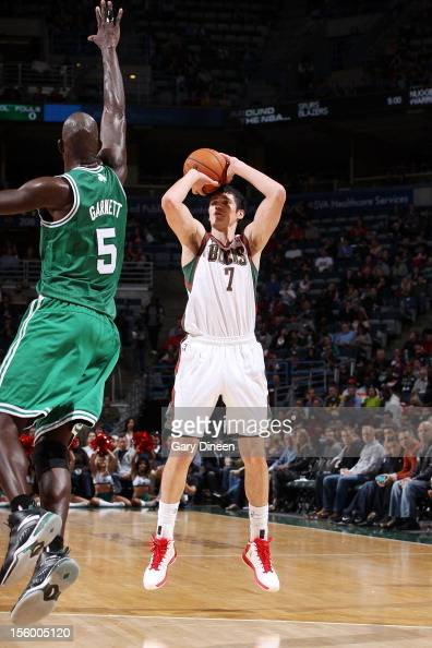 Ersan Ilyasova of the Milwaukee Bucks shoots against Kevin Garnett of the Boston Celtics during the NBA game on November 10 2012 at the BMO Harris...