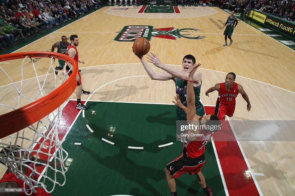 <a gi-track='captionPersonalityLinkClicked' href=/galleries/search?phrase=Ersan+Ilyasova&family=editorial&specificpeople=557070 ng-click='$event.stopPropagation()'>Ersan Ilyasova</a> #7 of the Milwaukee Bucks shoots against <a gi-track='captionPersonalityLinkClicked' href=/galleries/search?phrase=Landry+Fields&family=editorial&specificpeople=4184645 ng-click='$event.stopPropagation()'>Landry Fields</a> #2 of the Toronto Raptors on March 2, 2013 at the BMO Harris Bradley Center in Milwaukee, Wisconsin.