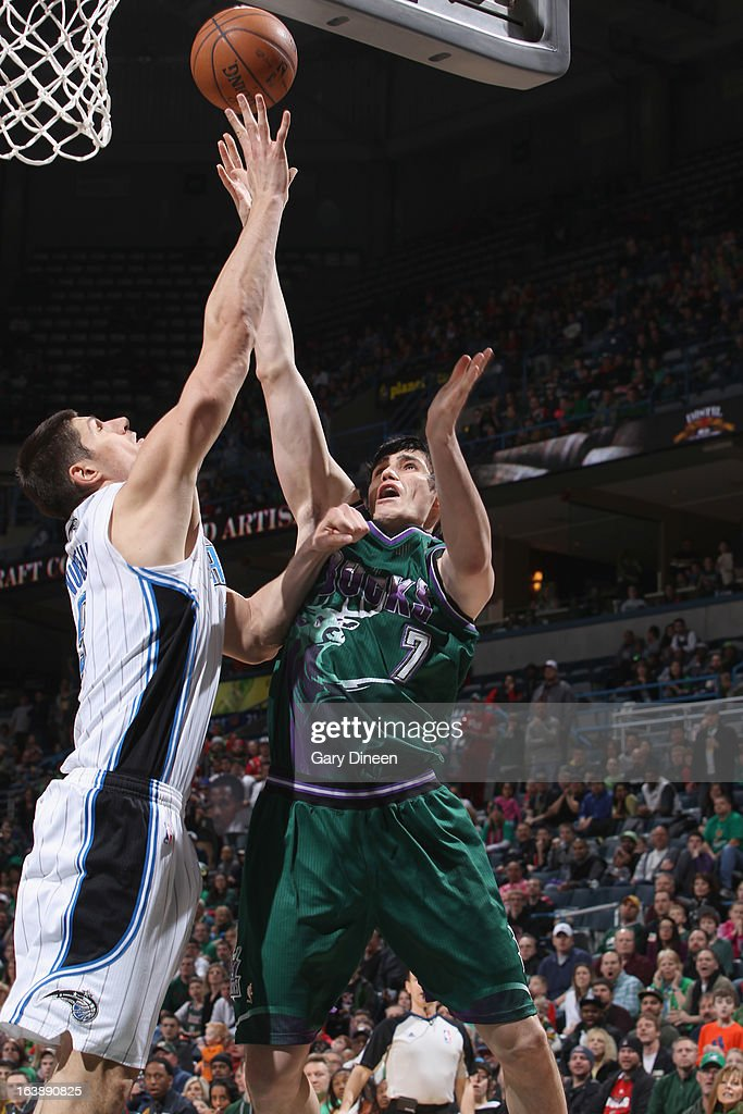 <a gi-track='captionPersonalityLinkClicked' href=/galleries/search?phrase=Ersan+Ilyasova&family=editorial&specificpeople=557070 ng-click='$event.stopPropagation()'>Ersan Ilyasova</a> #7 of the Milwaukee Bucks shoots against Nikola Vucevic #9 of the Orlando Magic on March 17, 2013 at the BMO Harris Bradley Center in Milwaukee, Wisconsin.