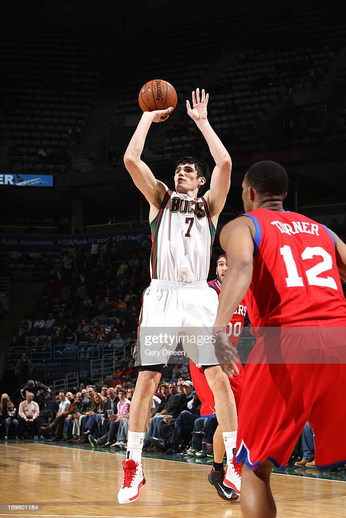 <a gi-track='captionPersonalityLinkClicked' href=/galleries/search?phrase=Ersan+Ilyasova&family=editorial&specificpeople=557070 ng-click='$event.stopPropagation()'>Ersan Ilyasova</a> #7 of the Milwaukee Bucks shoots against <a gi-track='captionPersonalityLinkClicked' href=/galleries/search?phrase=Spencer+Hawes&family=editorial&specificpeople=3848319 ng-click='$event.stopPropagation()'>Spencer Hawes</a> #00 of the Philadelphia 76ers on January 22, 2013 at the BMO Harris Bradley Center in Milwaukee, Wisconsin.