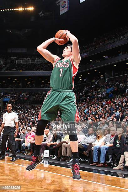 Ersan Ilyasova of the Milwaukee Bucks shoots against the Brooklyn Nets at the Barclays Center on November 19 2014 in in the Brooklyn borough of New...