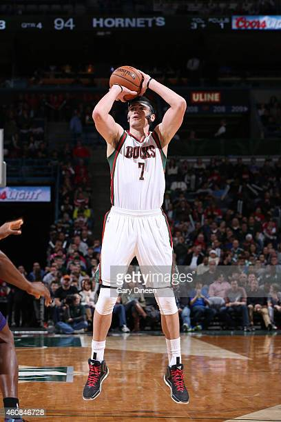 Ersan Ilyasova of the Milwaukee Bucks shoots against the Charlotte Hornets on December 23 2014 at the BMO Harris Bradley Center in Milwaukee...