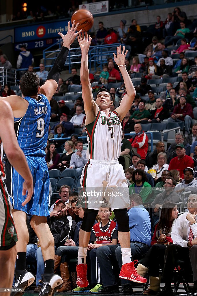 <a gi-track='captionPersonalityLinkClicked' href=/galleries/search?phrase=Ersan+Ilyasova&family=editorial&specificpeople=557070 ng-click='$event.stopPropagation()'>Ersan Ilyasova</a> #7 of the Milwaukee Bucks shoots against the Orlando Magic on February 18, 2014 at the BMO Harris Bradley Center in Milwaukee, Wisconsin.