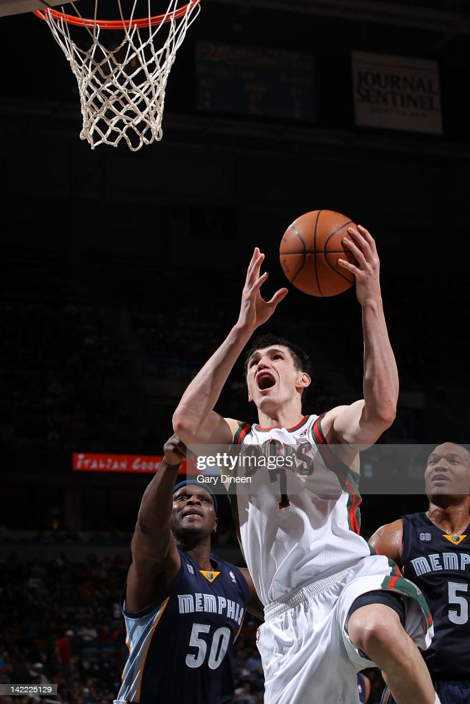 <a gi-track='captionPersonalityLinkClicked' href=/galleries/search?phrase=Ersan+Ilyasova&family=editorial&specificpeople=557070 ng-click='$event.stopPropagation()'>Ersan Ilyasova</a> #7 of the Milwaukee Bucks shoots against (L-R) <a gi-track='captionPersonalityLinkClicked' href=/galleries/search?phrase=Zach+Randolph&family=editorial&specificpeople=201595 ng-click='$event.stopPropagation()'>Zach Randolph</a> #50 and <a gi-track='captionPersonalityLinkClicked' href=/galleries/search?phrase=Marreese+Speights&family=editorial&specificpeople=4187263 ng-click='$event.stopPropagation()'>Marreese Speights</a> #5 of the Memphis Grizzlies on March 31, 2012 at the Bradley Center in Milwaukee, Wisconsin.