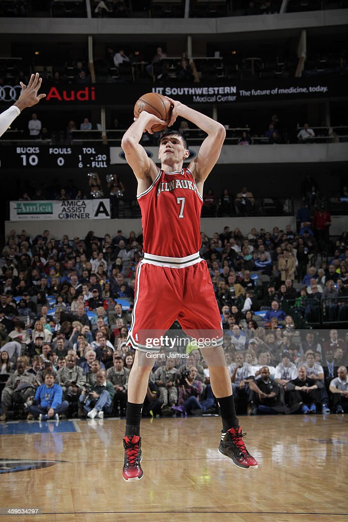 <a gi-track='captionPersonalityLinkClicked' href=/galleries/search?phrase=Ersan+Ilyasova&family=editorial&specificpeople=557070 ng-click='$event.stopPropagation()'>Ersan Ilyasova</a> #7 of the Milwaukee Bucks shoots the ball against the Dallas Mavericks on December 14, 2013 at the American Airlines Center in Dallas, Texas.