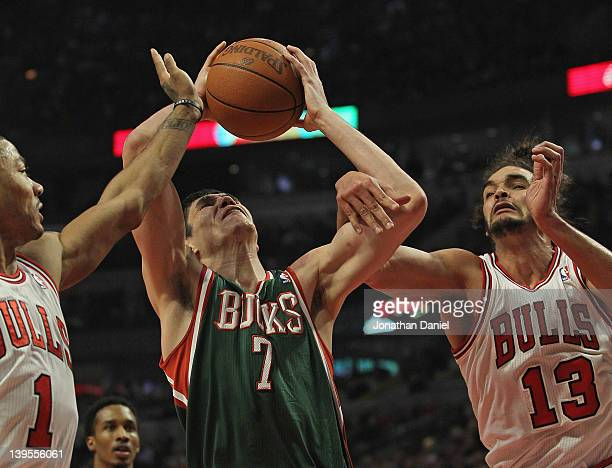 Ersan Ilyasova of the Milwaukee Bucks tries to shoot between Derrick Rose and Joakim Noah of the Chicago Bulls at the United Center on February 22...