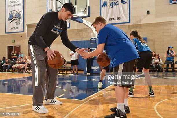 Ersan Ilyasova of the Orlando Magic helps host a clinic for kids on February 20 2016 at Amway Center in Orlando Florida NOTE TO USER User expressly...