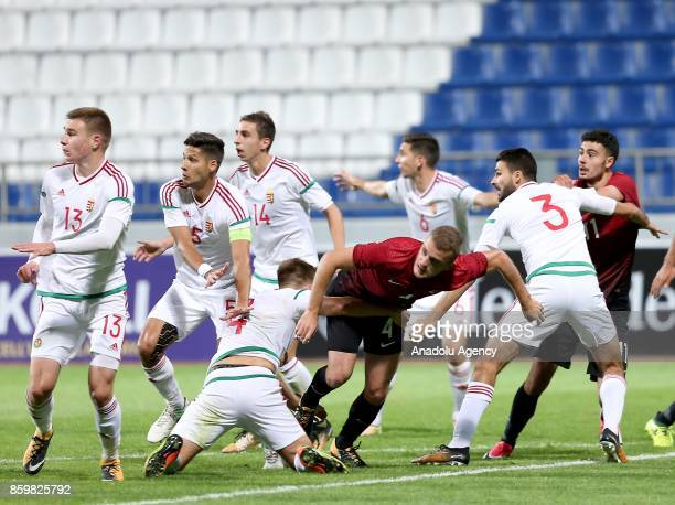 Ertugrul Ersoy of Turkey in action against Bence Toth and Bence Lenser of Hungary during the 2017 UEFA European Under21 Championship qualification...