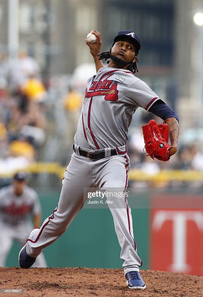 <a gi-track='captionPersonalityLinkClicked' href=/galleries/search?phrase=Ervin+Santana&family=editorial&specificpeople=243096 ng-click='$event.stopPropagation()'>Ervin Santana</a> #30 of the Atlanta Braves pitches in the first inning against the Pittsburgh Pirates during the game at PNC Park on August 18, 2014 in Pittsburgh, Pennsylvania.