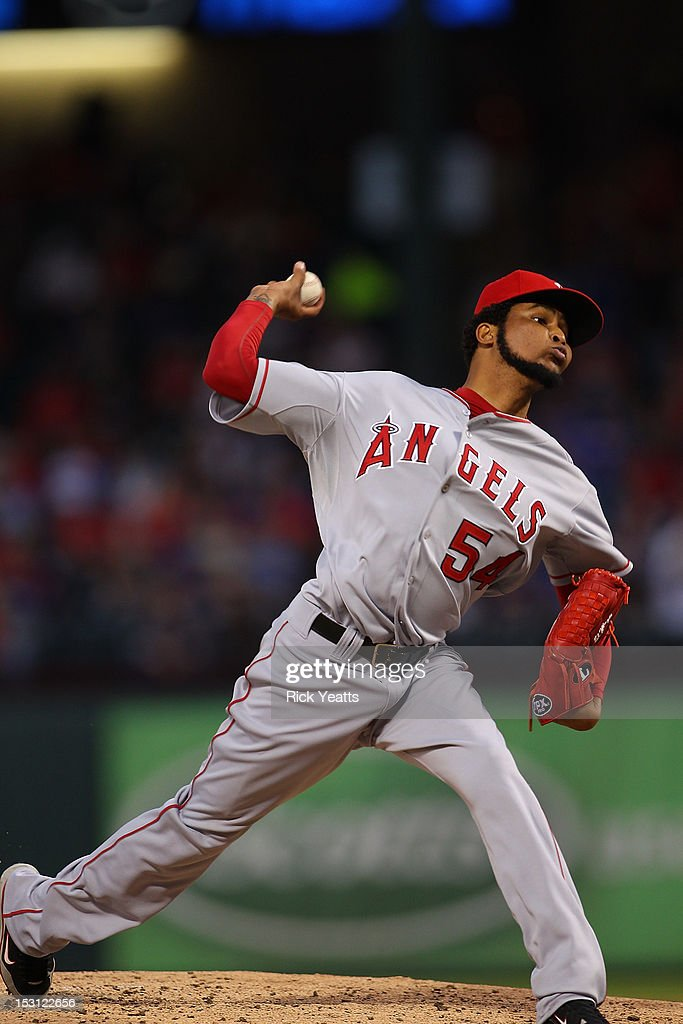 <a gi-track='captionPersonalityLinkClicked' href=/galleries/search?phrase=Ervin+Santana&family=editorial&specificpeople=243096 ng-click='$event.stopPropagation()'>Ervin Santana</a> #54 of the Los Angeles Angels of Anaheim pitches in game two of the double header against the Texas Rangers at Rangers Ballpark in Arlington on September 30, 2012 in Arlington, Texas.
