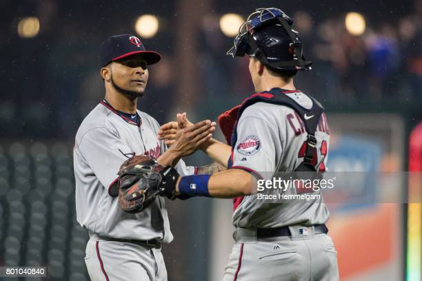 Ervin Santana of the Minnesota Twins celebrates his complete game shutout with Jason Castro against the Baltimore Orioles on May 23 2017 at Oriole...