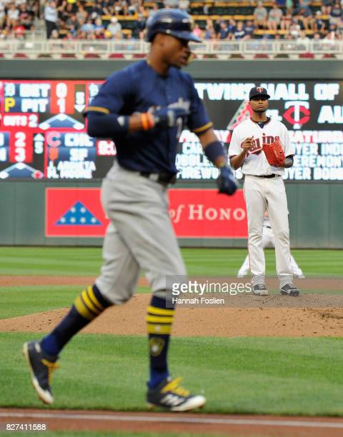 Ervin Santana of the Minnesota Twins looks on as Keon Broxton of the Milwaukee Brewers rounds the bases after hitting a solo home run during the...