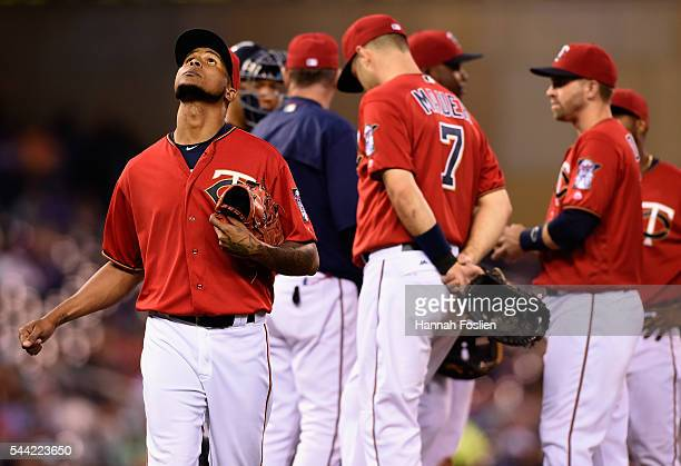 Ervin Santana of the Minnesota Twins reacts after manager Paul Molitor relieved him from the game against the Texas Rangers during the seventh inning...