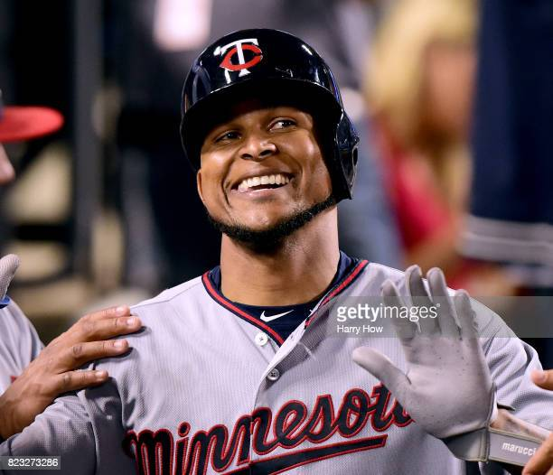Ervin Santana of the Minnesota Twins reacts to his run in the dugout to take a 50 lead over the Los Angeles Dodgers during the fourth inning at...