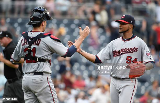 Ervin Santana of the Minnesota Twins right is congratulated by Jason Castro getting the final out during the ninth inning of a baseball game against...