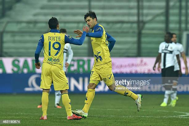 Ervin Zukanovic of AC Chievo Verona celebrates after scoring the opening goal with team mate Ruben Botta during the Serie A match between Parma FC...