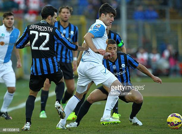Ervin Zukanovic of AC Chievo Verona is challenged by Davide Zappacosta of Atalanta BC during the Serie A match between Atalanta BC and AC Chievo...