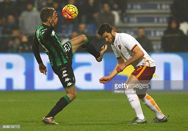 Ervin Zukanovic of AS Roma competes for the ball with Domenico Berardi of US Sassuolo Calcio during the Serie A match between US Sassuolo Calcio and...