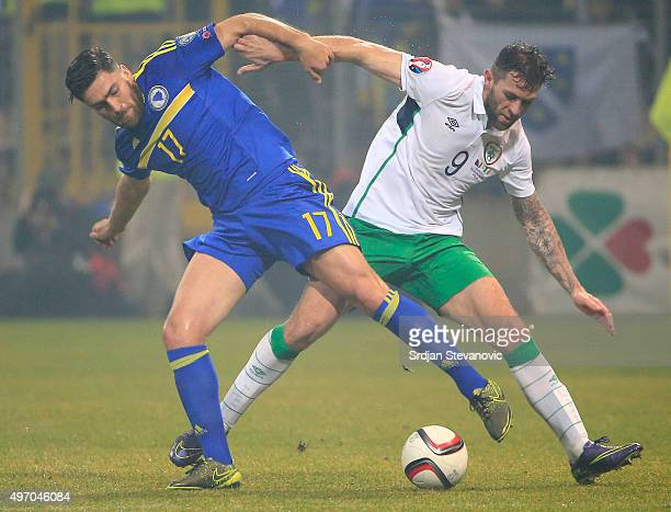 HERZEGOVINA NOVEMBER 13 Ervin Zukanovic of Bosnia competes for the ball with the Daryl Murphy of Ireland during the EURO 2016 Qualifier PlayOff First...