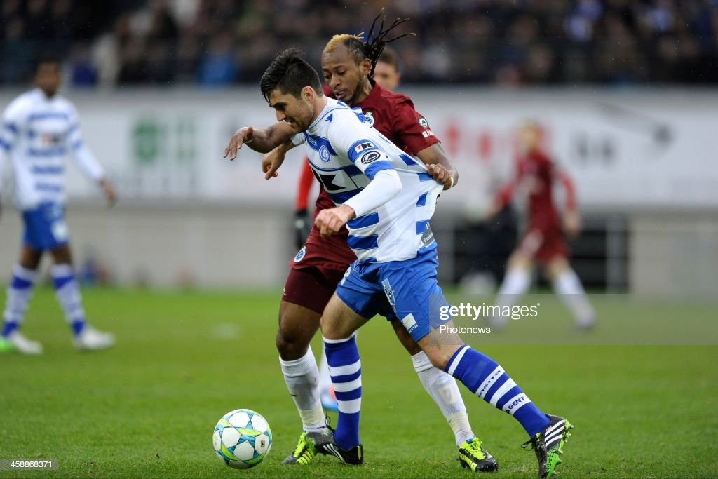 Ervin Zukanovic of KAA Gent battles for the ball with Mohamed Tchite of Club Brugge during the Jupiler League match between KAA Gent and Club Brugge on December 22, 2013 at the Ghelamco arena in Gent, Belgium.