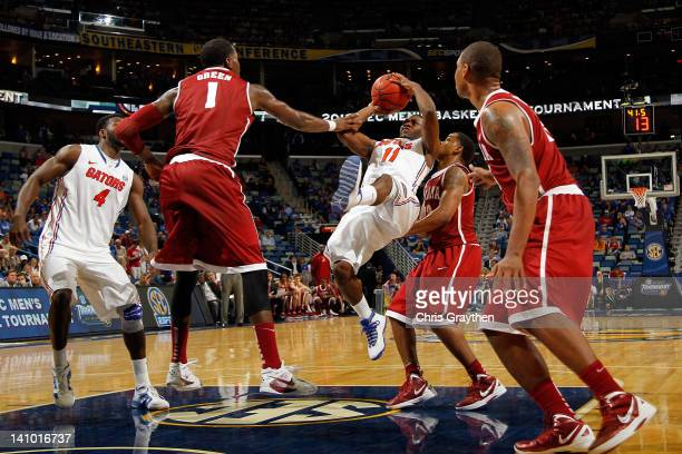 Erving Walker of the Florida Gators attempts a shot against the JaMychal Green of the Alabama Crimson Tide during their quarterfinal game in the 2012...