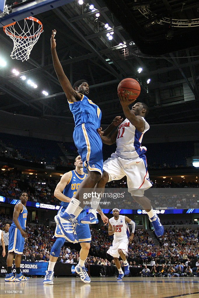 Erving Walker of the Florida Gators drives for a shot attempt against Anthony Stover of the UCLA Bruins during the third round of the 2011 NCAA men's...