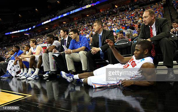 Erving Walker of the Florida Gators looks on as he lies in front of the bench in the second hal against the Norfolk State Spartans during the third...