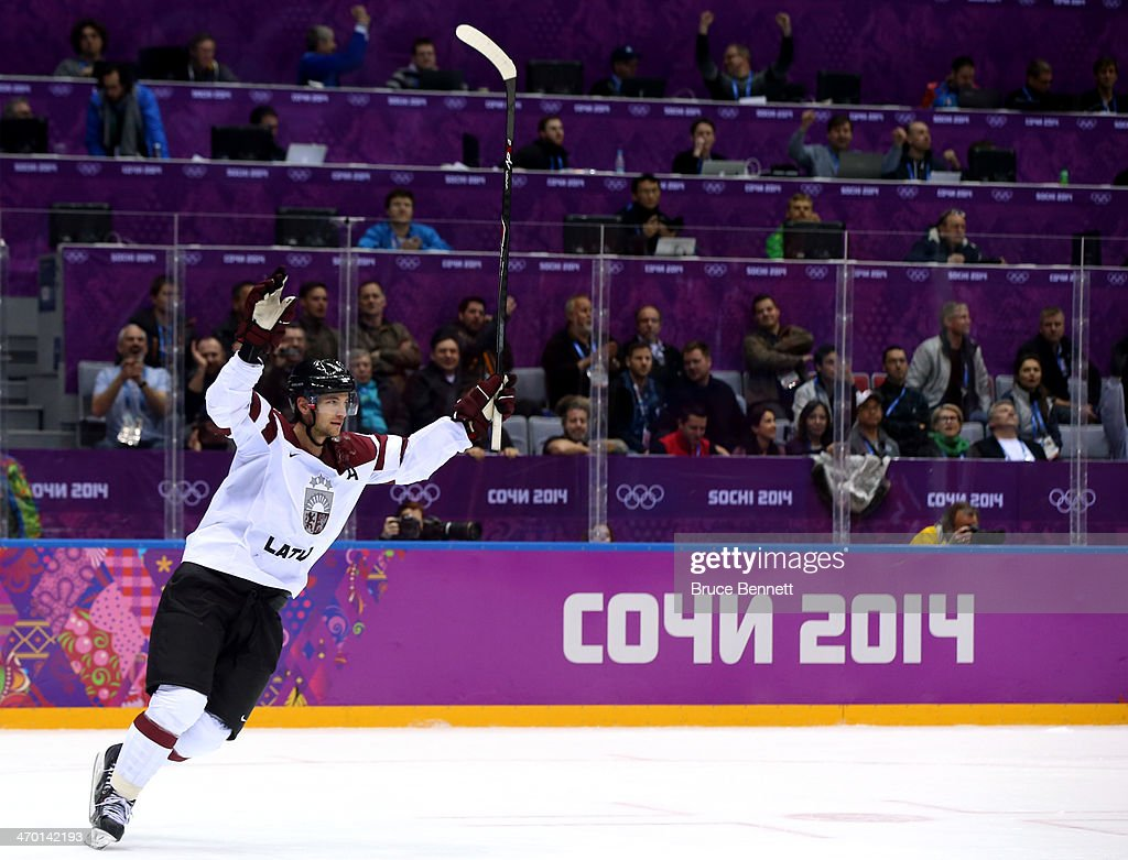 Ervins Mustukovs #1 of Latvia scores a open net goal late in the third period against Switzerland during the Men's Ice Hockey Qualification Playoff game on day eleven of the Sochi 2014 Winter Olympics at Bolshoy Ice Dome on February 18, 2014 in Sochi, Russia.