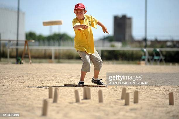 Erwan a young Molkky player throws a skittle while playing Molkky on June 21 2014 in L'Hermitage western France The Molkky is a skittle game created...